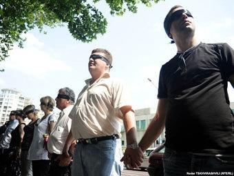 Акция в поддержку задержанных фотографов. Фото RFE/RL